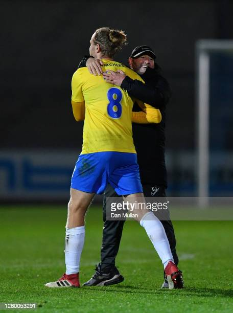 Gary Johnson, Manager of Torquay United celebrates with Asa Hall of Torquay United at the final whistle during the Vanarama National League match...