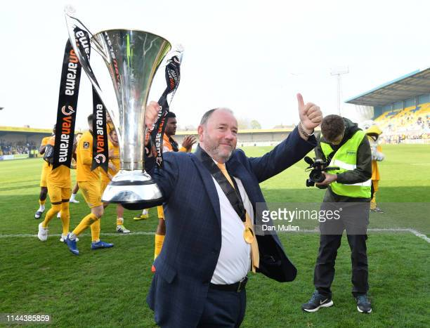 Gary Johnson, Manager of Torquay United celebrates with the Vanarama National League South Trophy as Torquay United are crowned champions following...