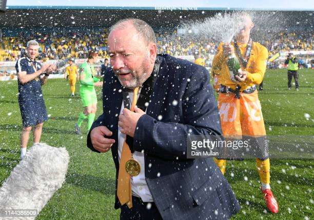 Gary Johnson, Manager of Torquay United is sprayed with champagne in celebration as Torquay United are crowned champions of the Vanarama National...