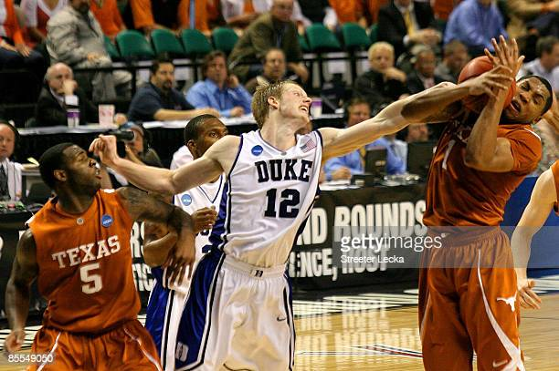 Gary Johnson of the Texas Longhorns grabs a rebound against Kyle Singler of the Duke Blue Devils during the second round of the NCAA Division I Men's...