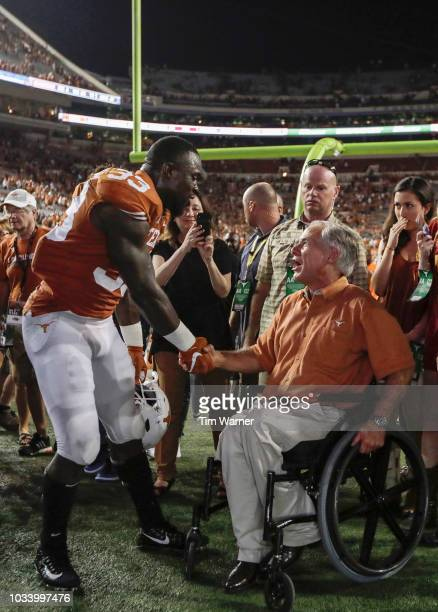 Gary Johnson of the Texas Longhorns shakes hands with Texas Governor Greg Abbott after the game against the USC Trojans at Darrell K RoyalTexas...