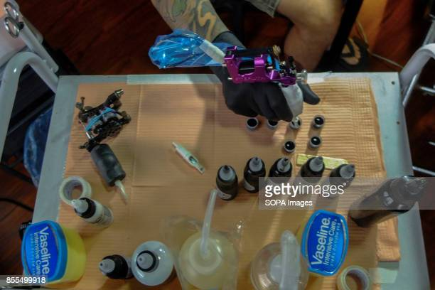 Gary Jones is seen while preparing the tattoo equipment and hygiene apparatus before the customer arrive in his studio Gary Jones is one of the...
