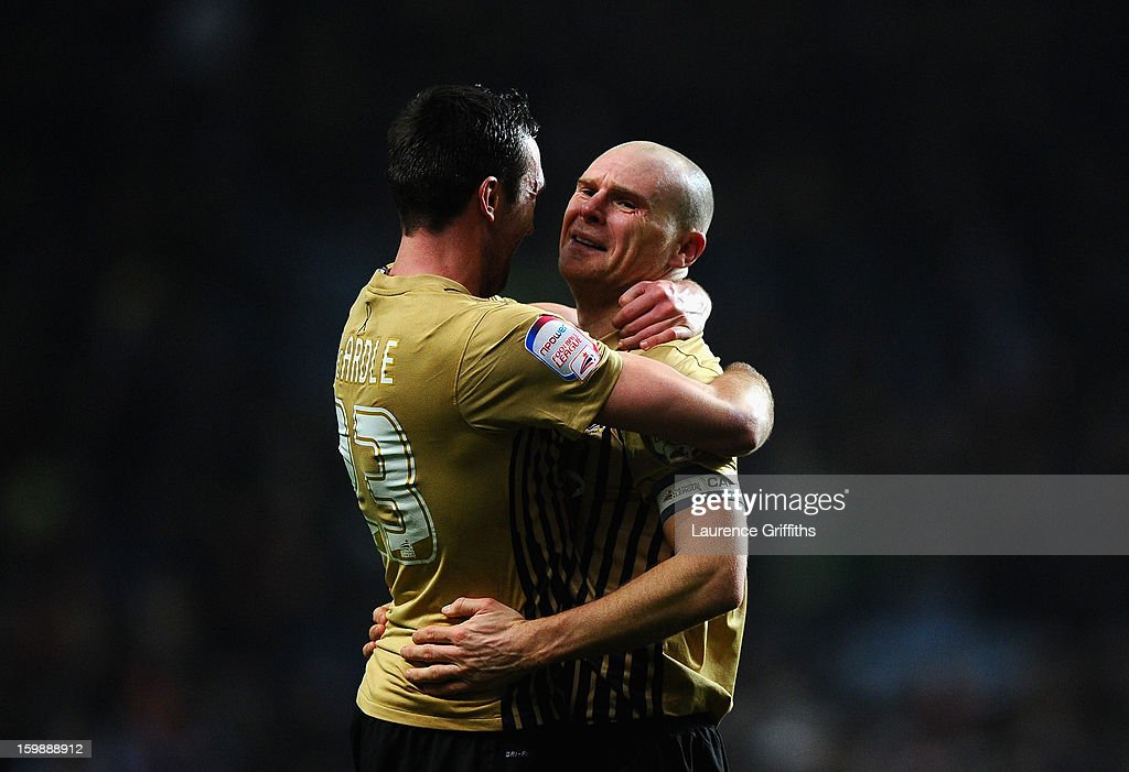 Gary Jones (r) of Bradford City celebrates reaching the final with team-mate Rory McArdle at the end of the Capital One Cup Semi-Final Second Leg between Aston Villa and Bradford City at Villa Park on January 22, 2013 in Birmingham, England.