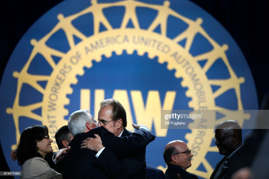 Gary Jones (center), the newly-elected President of the United Auto Workers (UAW), gets a hug before addressing the 37th UAW Constitutional Convention June14, 2018 at Cobo Center in Detroit, Michigan. Jones was formerly the Director of UAW Region 5. The outgoing President is Dennis Williams, who served one term and was elected in 2014.