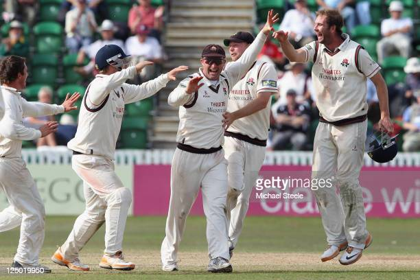 Gary Keedy is congratulated by his Lancashire team mates after running out Gemaal Hussain during the LV County Championship match between Somerset...