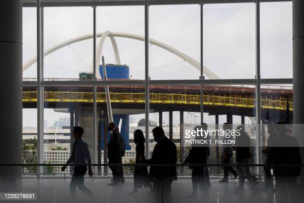Gary Kelly, chief executive officer of Southwest Airlines Co., walks past a window during a tour as the LAX Theme Building stands in the distance for...