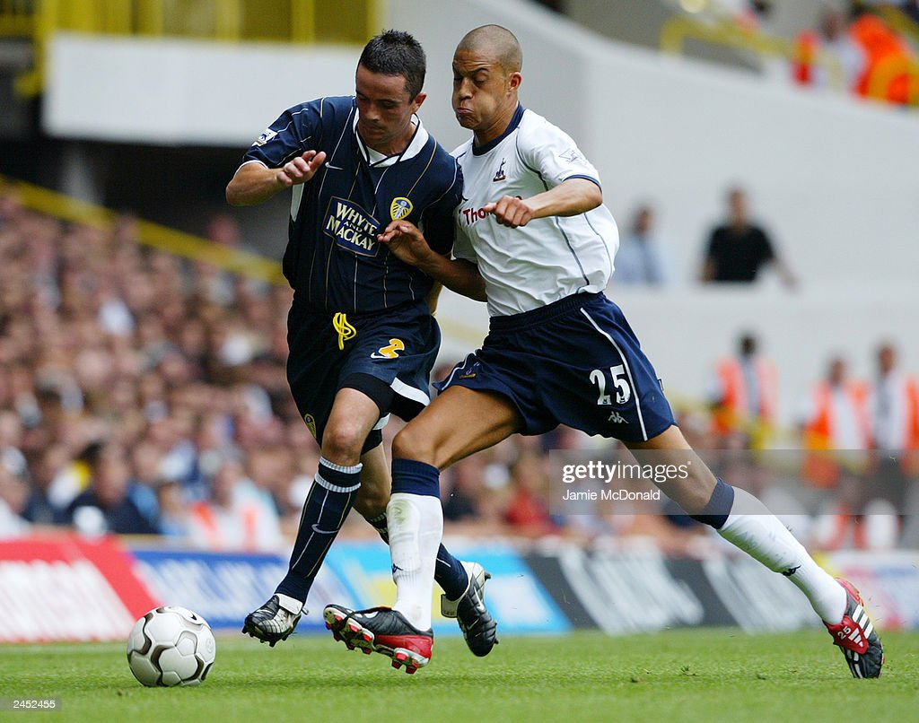 Gary Kelly of Leeds United is brushed off the ball by Bobby Zamora of Tottenham Hotspur during the FA Barclaycard Premiership match held on August 23, 2003, at White Hart Lane, in London. Tottenham Hotspur won the match 2-1.
