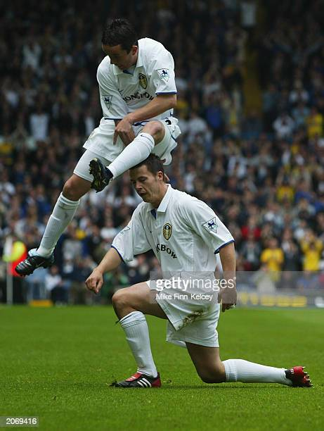 Gary Kelly of Leeds United jumps over teammate Ian Harte after he scores the opening goal of the match during the FA Barclaycard Premiership match...