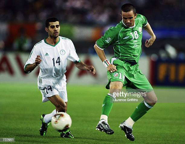 Gary Kelly of the Republic of Ireland clears the ball from Abdulaziz Al Khathran of Saudi Arabia during the FIFA World Cup Finals 2002 Group E match...