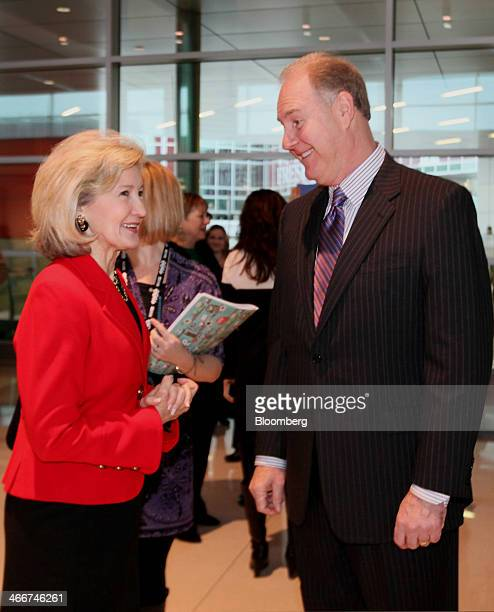 Gary Kelly president and chief executive officer of Southwest Airlines Co right speaks with Senator Kay Bailey Hutchison a Republican from Texas...