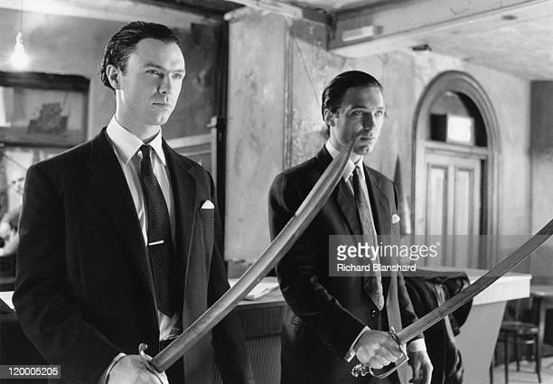 Gary Kemp and his brother Martin as British gangsters Ronnie and Reggie Kray respectively in 'The Krays' directed by Peter Medak 1990 In this scene...