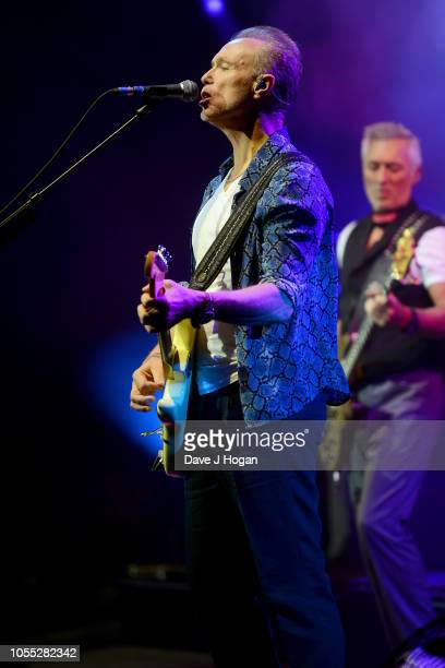 Gary Kemp and Martin Kemp of Spandau Ballet perform on stage at Eventim Apollo on October 29, 2018 in London, England.