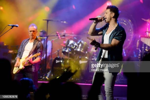 Gary Kemp and Ross William Wild of Spandau Ballet perform on stage at Eventim Apollo on October 29, 2018 in London, England.