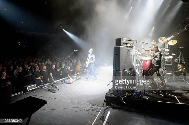Gary Kemp and Steve Norman of Spandau Ballet perform on stage at Eventim Apollo on October 29, 2018 in London, England.