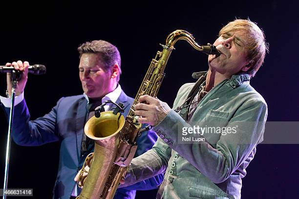 Gary Kemp and Steve Norman of Spandau Ballet perform on stage at The O2 Arena on March 17 2015 in London United Kingdom
