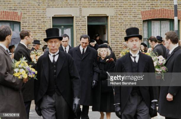 Gary Kemp Martin Kemp and Billie Whitelaw in a funeral scene from the biopic film 'The Krays' 1990
