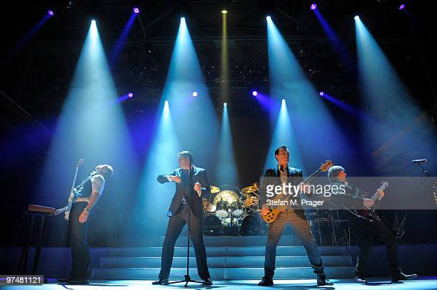 Gary Kemp Tony Hadley Martin Kemp and Steve Norman perform on stage at Zenith on March 5 2010 in Munich Germany