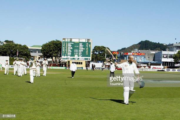 Gary Kirsten of South Africa is clapped off by his team mates as he finishes his test career out for 77 during the 5th day of the 3rd Test between...