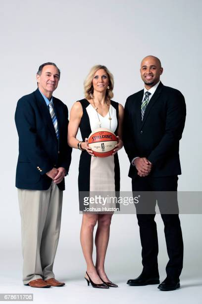 Gary Kloppenburg Jenny Boucek and Ryan Webb of the Seattle Storm poses for a portrait during media day on May 3 2017 at Key Arena in Seattle...