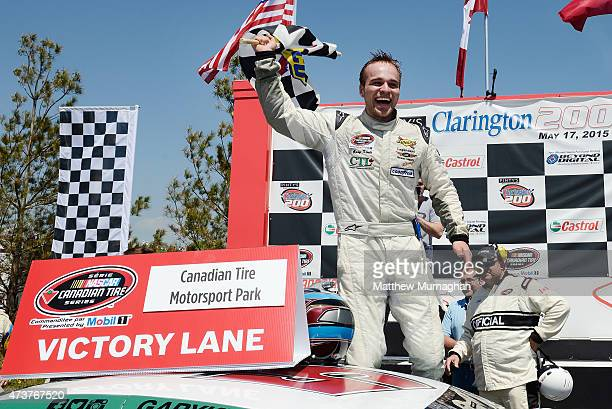 Gary Klutt driver of the CTL Corp/Legendary Motorcar Chevrolet exits his car after winning the Pinty's presents the Clarington 200 at Canadian Tire...