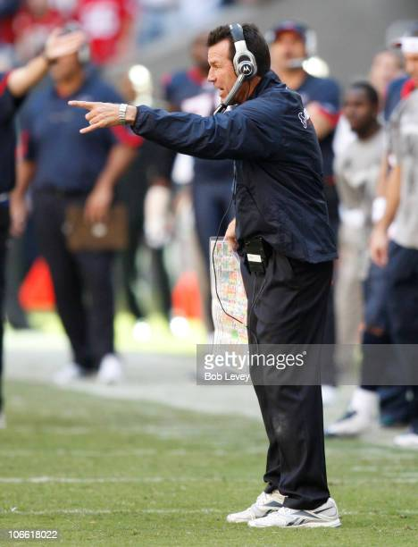 Gary Kubiak of the Houston Texans argues with referee Mike Carey as he calls intentional grounding on him during a game against the San Diego...