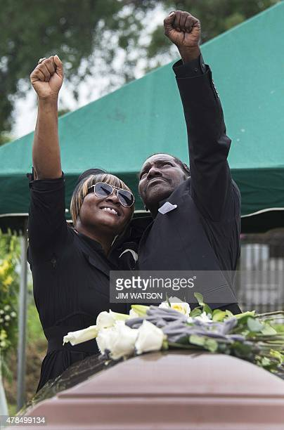 Gary L Washington son of Emanuel AME Church shooting victim Ethel Lance and another family member hold up their fists during her burial at the...