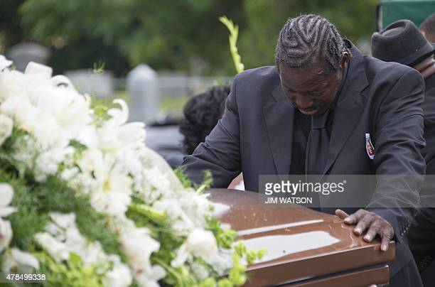 Gary L Washington son of Emanuel AME Church shooting victim Ethel Lance prays on her casket during Lance's burial at the Emanuel AME Church Cemetery...