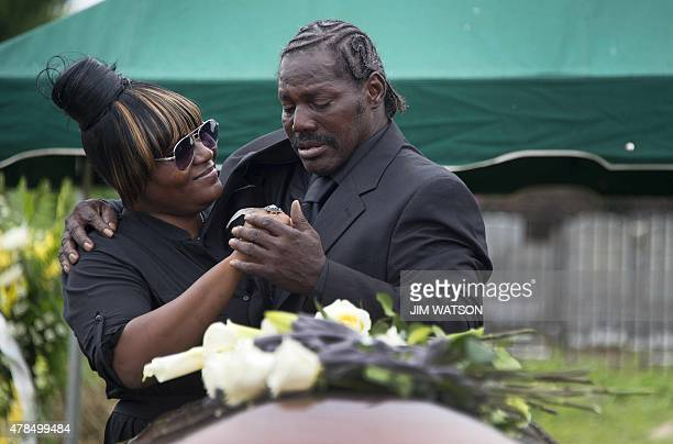 Gary L Washington son of Emanuel AME Church shooting victim Ethel Lance hugs one of Lance's granddaughters during her burial at the Emanuel AME...