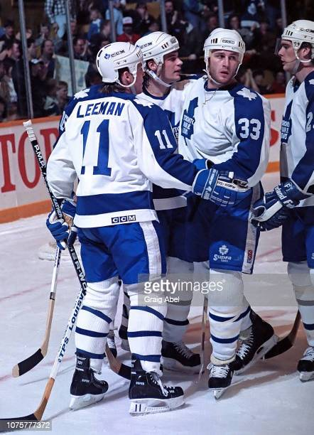 Gary Leeman Dave Reid Al Iafrate and Tom Kurvers of the the Toronto Maple Leafs skate against the Edmonton Oilers during NHL game action March 10...