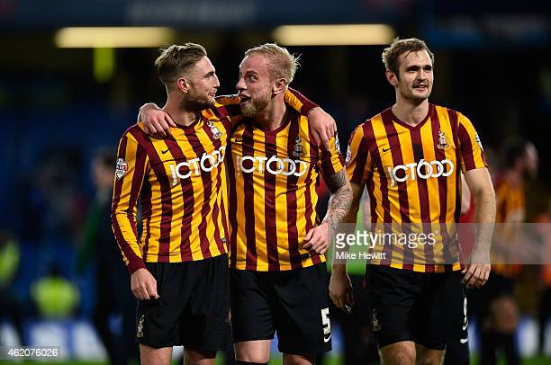 Gary Liddle of Bradford City Andrew Davies of Bradford City and James Hanson of Bradford City celebrate following their team's 42 victory during the...