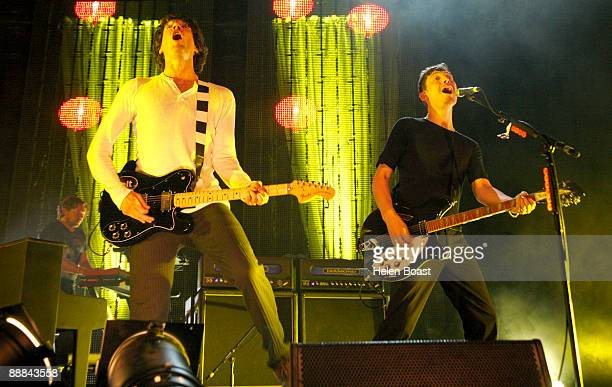 Gary lightbody and Nathan Connolly of Snow Patrol perform on stage at The Roundhouse on July 5 2009 in London England