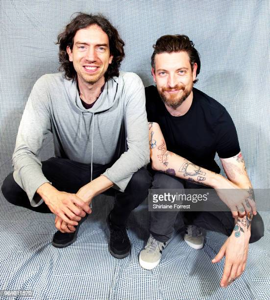 Gary Lightbody and Nathan Connolly of Snow Patrol pose backstage before an instore signing and performance of their new album 'Wildness' at HMV...