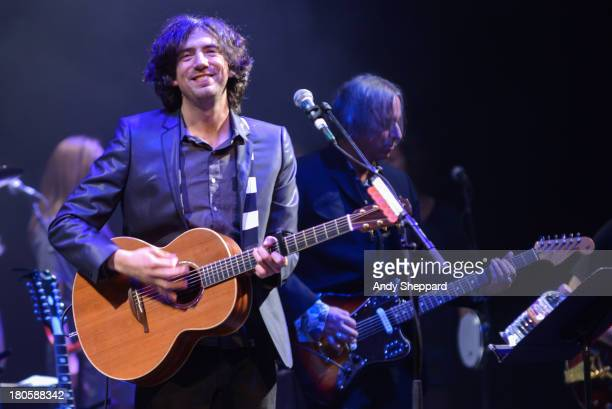 Gary Lightbody and Peter Buck of the band Tired Pony perform on stage at Barbican Centre on September 14, 2013 in London, England.