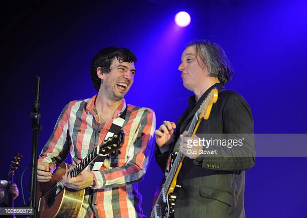 Gary Lightbody and Peter Buck perform on stage at The Forum on July 14 2010 in London England