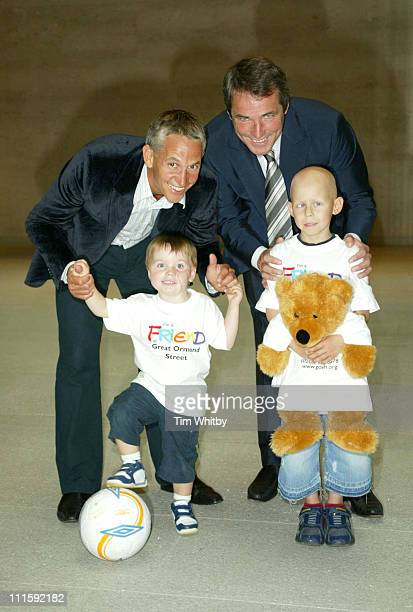 Gary Lineker and Alan Hansen with Tommy Morgan and Ethan Foster who are both Great Ormond Street Hospital patients