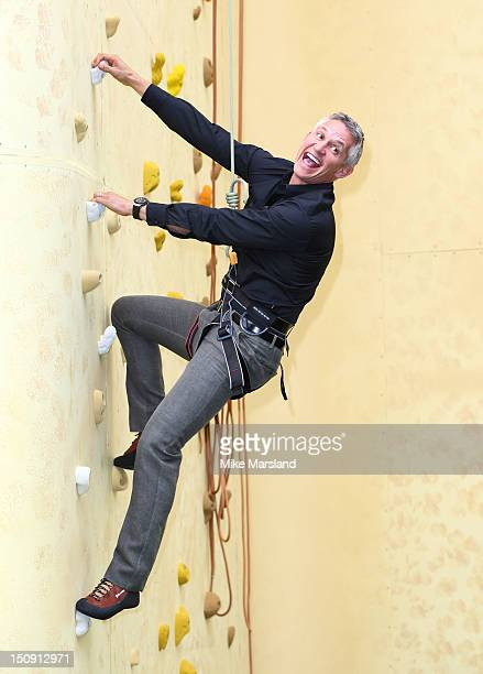 Gary Lineker climbs a wall as he attends the launch of Walkers Deep Ridged crisp at The Old Truman Brewery on August 29 2012 in London England