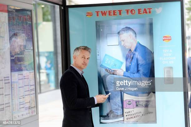 Gary Lineker meets his virtual self at the UK's first twitter vending machine for Walkers 'Do Us A Flavour' on August 28 2014 in London England