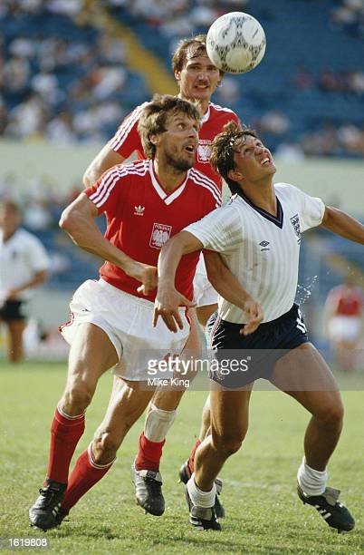 Gary Lineker of England is challenged by Majewski of Poland during their match in the Mexico World Cup Lineker scored all three goals in England's 30...