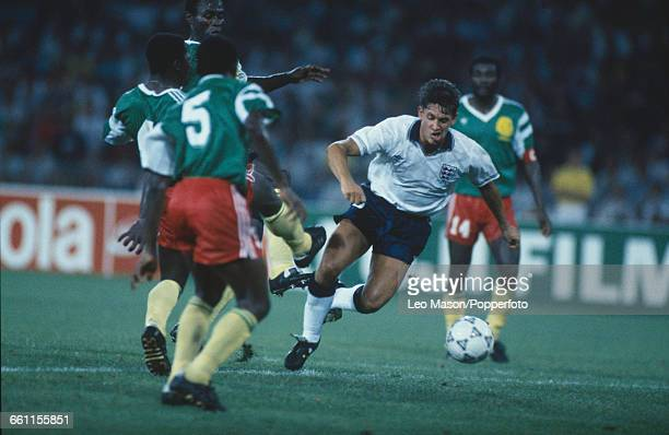Gary Lineker of England makes a run through the Cameroon defence in the 1990 FIFA World Cup quarterfinal game between Cameroon and England at the...