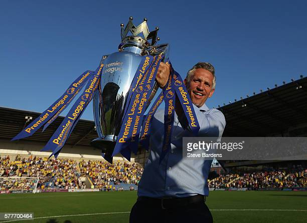 Gary Lineker poses for a picture with the Premier League Trophy prior to the pre-season friendly between Oxford City and Leicester City at Kassam...