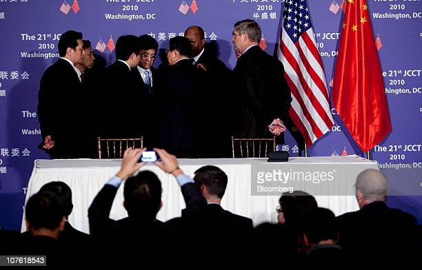 Gary Locke US secretary of commerce from left Ron Kirk US trade representative and Tom Vilsack US secretary of agriculture talk to Chinese officials...