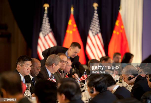 Gary Locke US secretary of commerce left to right Ron Kirk US trade representative and Tom Vilsack US secretary of agriculture participate in the...
