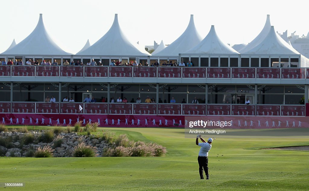 Gary Lockerbie of England plays his third shot on the 18th hole during the third round of the Commercial Bank Qatar Masters held at Doha Golf Club on January 25, 2013 in Doha, Qatar.