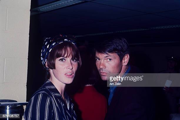 Gary Lockwood with his wife Stefanie Powers She is wearing a navy and white striped jacket and scarf circa 1970 New York