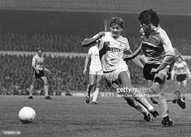 Gary Mabbutt of Tottenham Hotspur competes for the ball with Marc Degryse of Club Brugge during the UEFA Cup second round second leg match at White...
