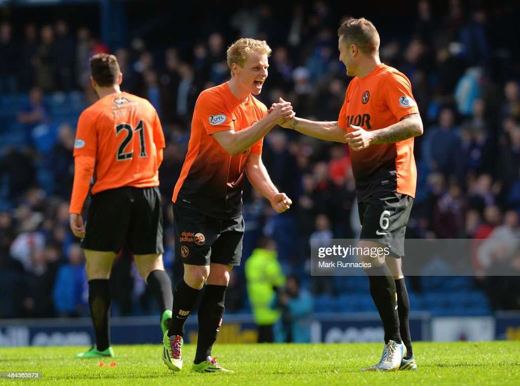 Gary Mackay-Steven of Dundee United celebrates with team mate Paul Paton as Dundee United win the William Hill Scottish Cup Semi Final between Rangers and Dundee United at Ibrox Stadium on April 12, 2014 in Glasgow, Scotland.