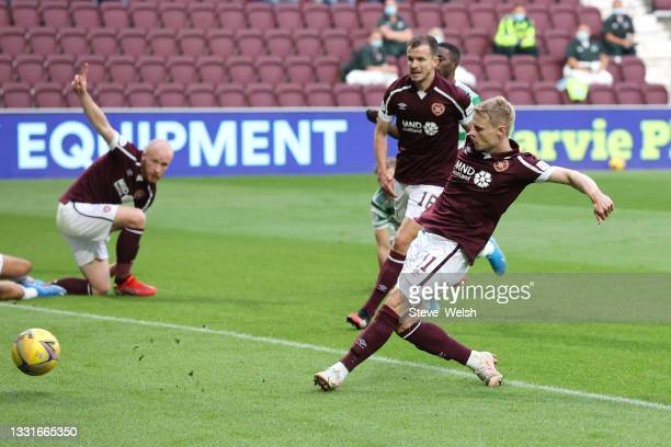 Gary Mackay-Steven of Heart of Midlothian scores his team's first goal during the Ladbrokes Scottish Premiership match between Heart of Midlothian...