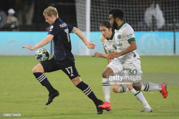 Gary MackaySteven of New York City controls the ball past Eryk Williamson of Portland Timbers during a quarter final match of MLS Is Back Tournament...