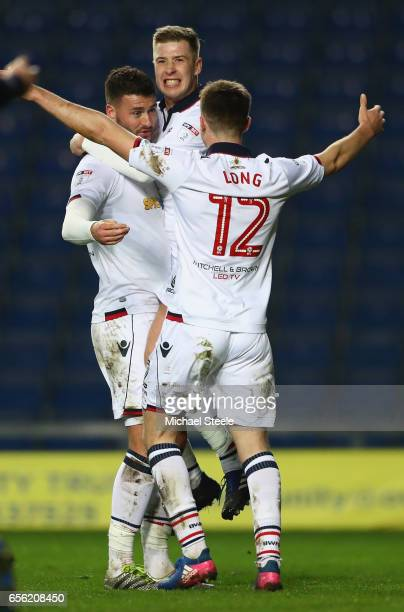 Gary Madine Josh Vela and Chris Long of Bolton celebrate the third goal an own goal scored by Chey Dunkley of Oxford during the Sky Bet League One...