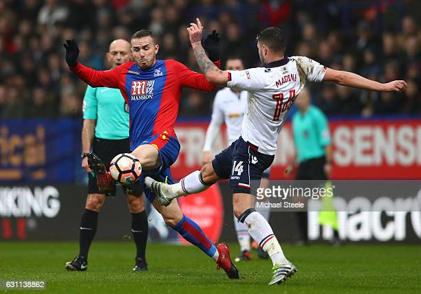 Gary Madine of Bolton and Jordan Mutch of Crystal Palace in action during the Emirates FA Cup third round match between Bolton Wanderers and Crystal...